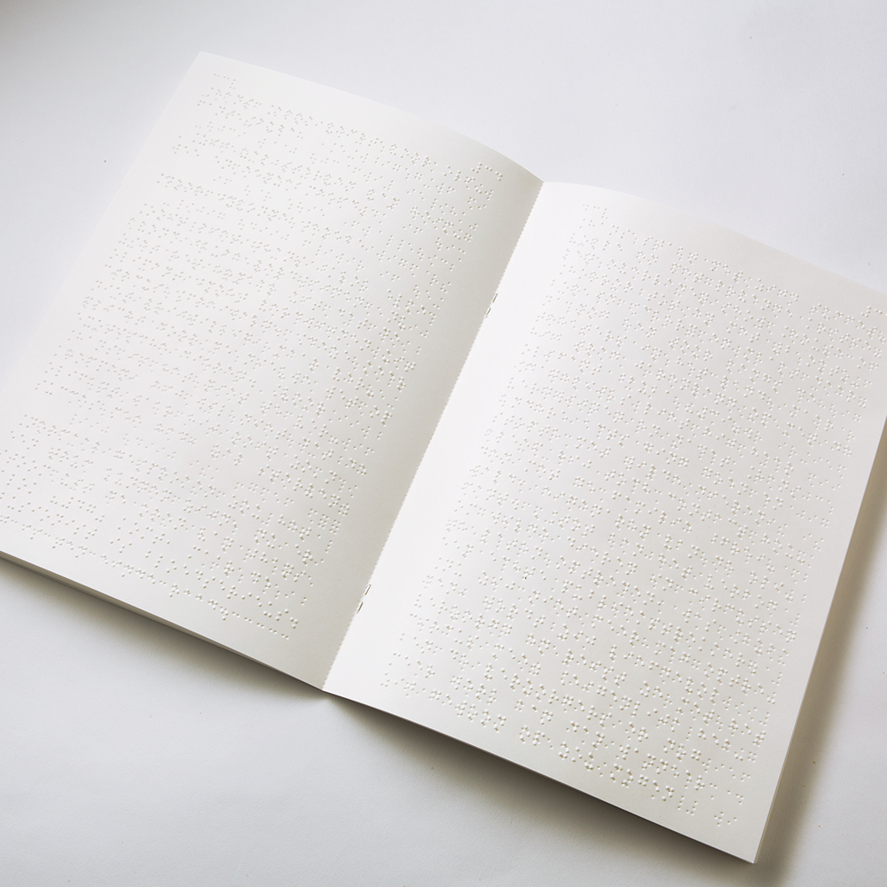 Laid-open Braille booklet in A3 size, folded to A4 format