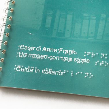 Information booklet of Anne Frank House in Braille with plastic sheet in Braille