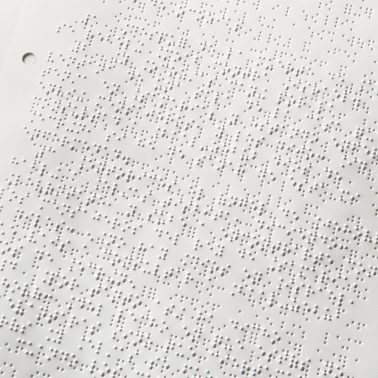 Sheet printed double-sided in Braille and punched with four holes for ring binder