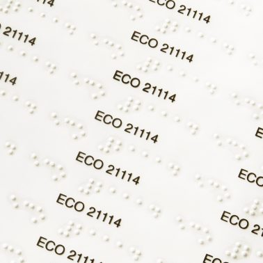 Transparent labels with printed text and Braille